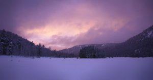 Purple sunset over snowy mountains